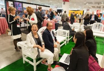 A picture of people enjoying the Click & Collect Show USA networking zone